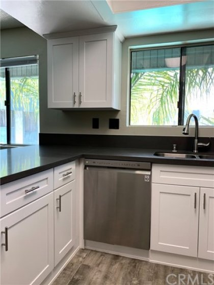 New kitchen cabinets, countertop, sink, faucet, garage disposal, and dishwasher