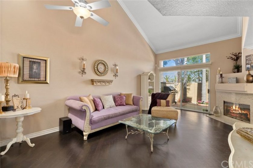 Vaulted ceiling accented with crown molding- Raised base boards enhance the wood laminated flooring-