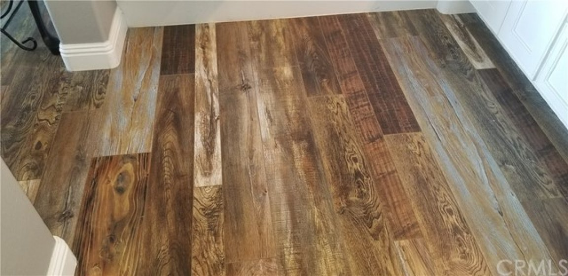 Clear shot of the flooring - it's just beautiful - BUT if buyer wants, they can have sanded and simply change the color per the designer - so lots of choices!