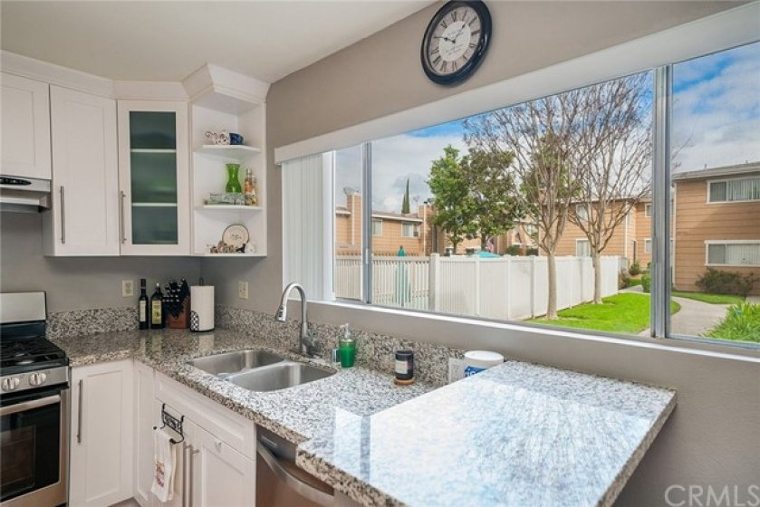 Newer, contemporary granite counter tops with white cabinets.