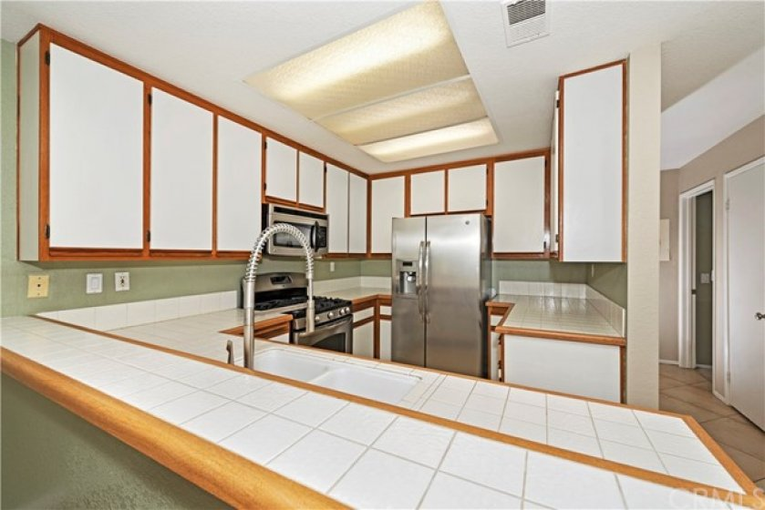 Spacious kitchen with lots of cabinets and counter space boasting stainless steel appliances.