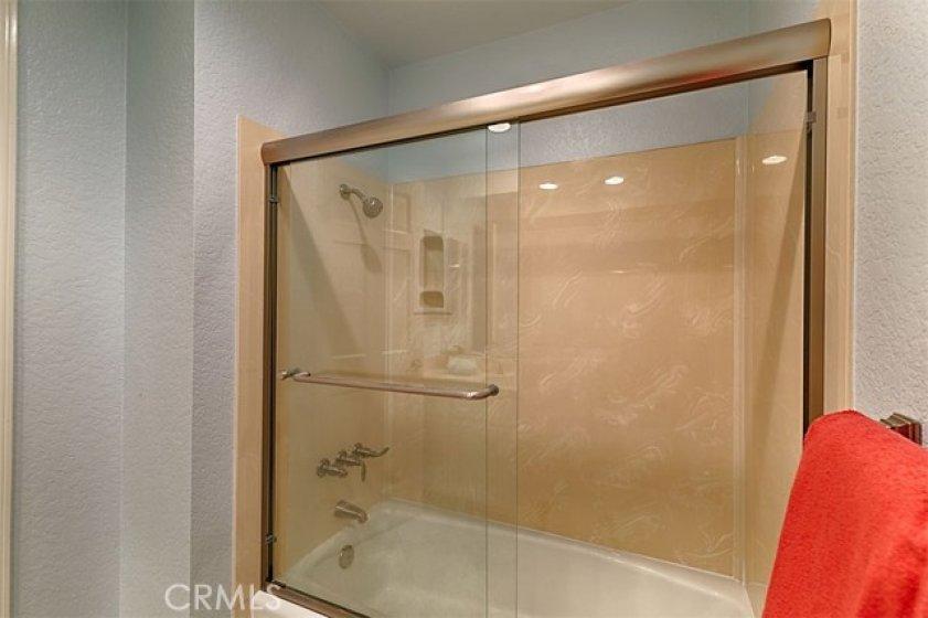Secondary bathroom has tub/shower combo.