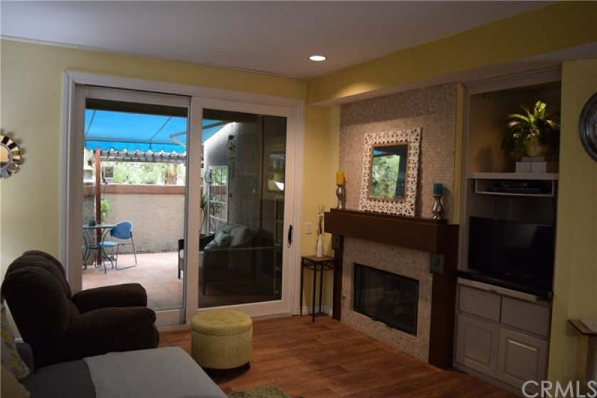 Fireplace in Living Room - Slider out to private patio
