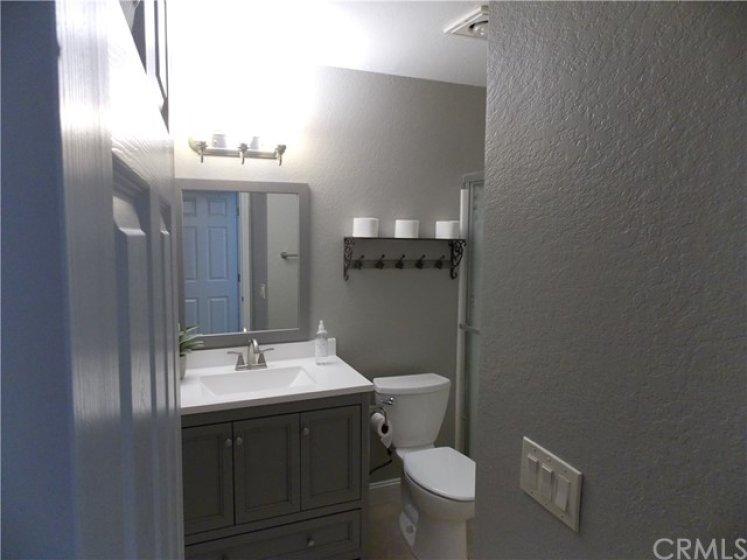 Bath #1 New Vanity, Mirror, Baseboard and Toilet. Plus Fresh Paint