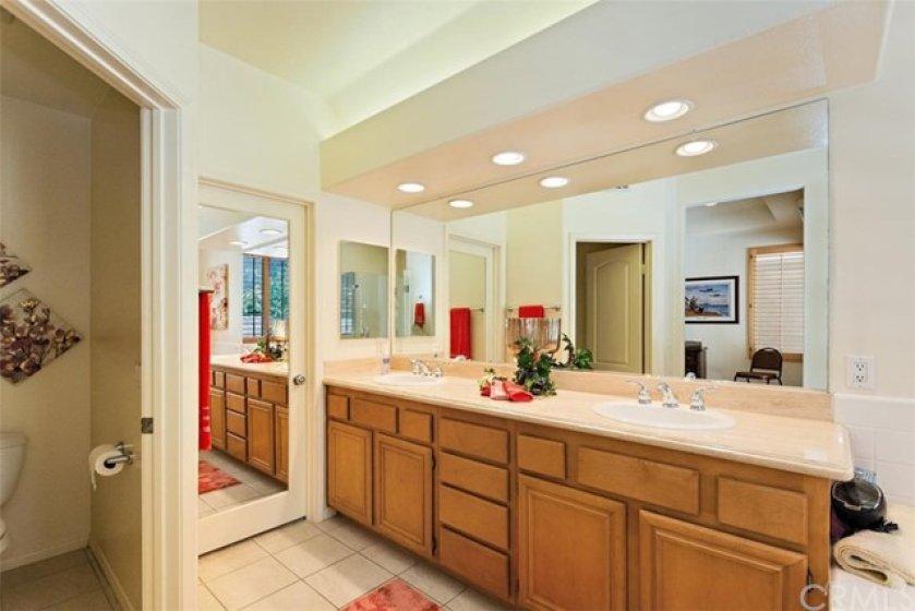 Dual Vanity Sinks, Mirrored Wardrobe Door, Large Walk-In Closet within Master Bath.