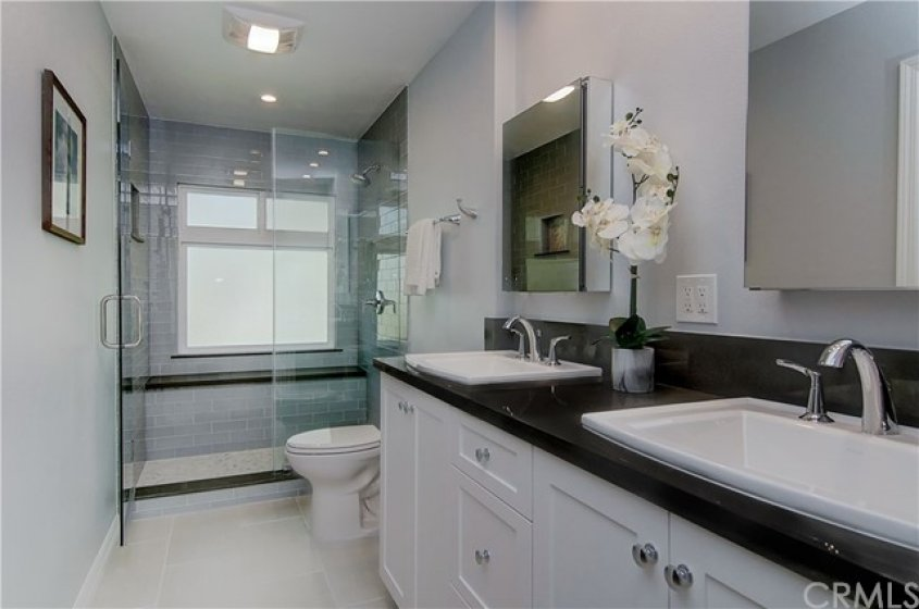 Master bath is a WOW...completely remodeled with dual sink vanity and gorgeous shower with bench seat.