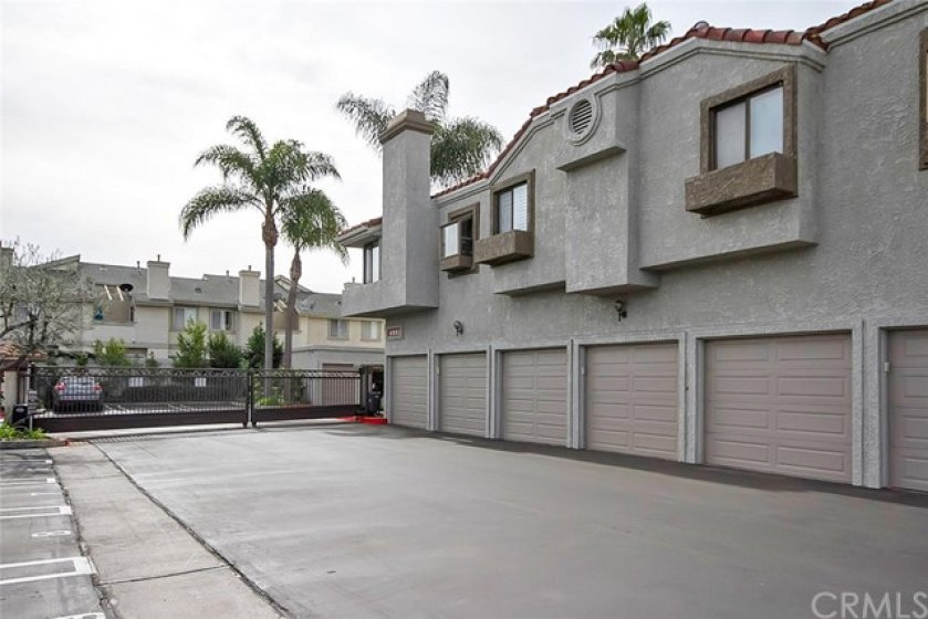 Single car garage plus one reserved parking space in gated community