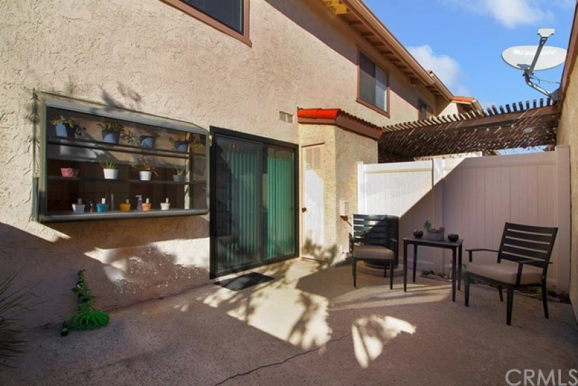 Spacious back patio with access to home through sliding door.