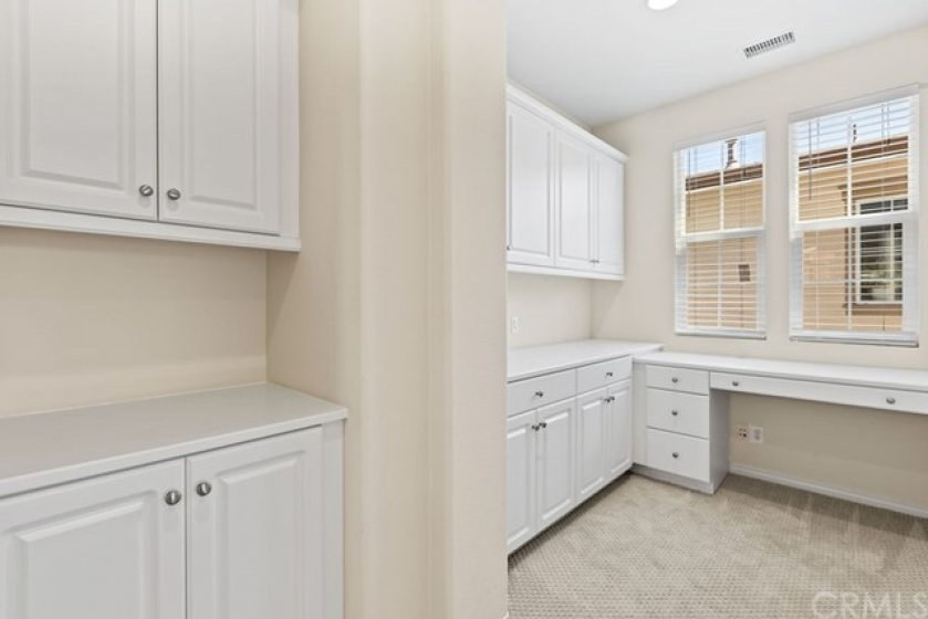 This study/tech nook in the second level is well suited for casual office space with tons of cabinet storage.