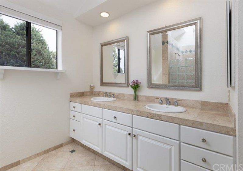Two sink vanity w/mirrors and window