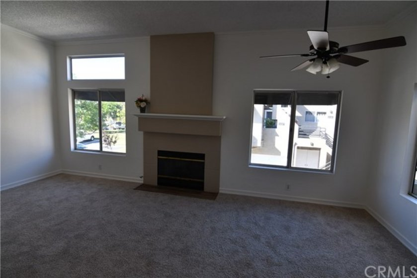 Additional view of the living room and the upgraded fireplace mantle. Note how light and bright it is. All new carpet and freshly painted.