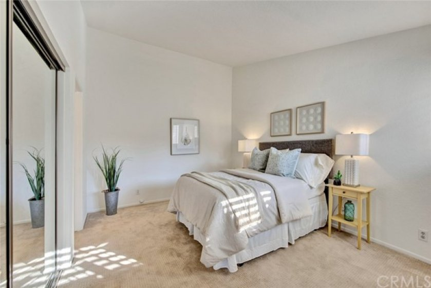 Very spacious master bedroom has vaulted ceiling and mirrored closet doors