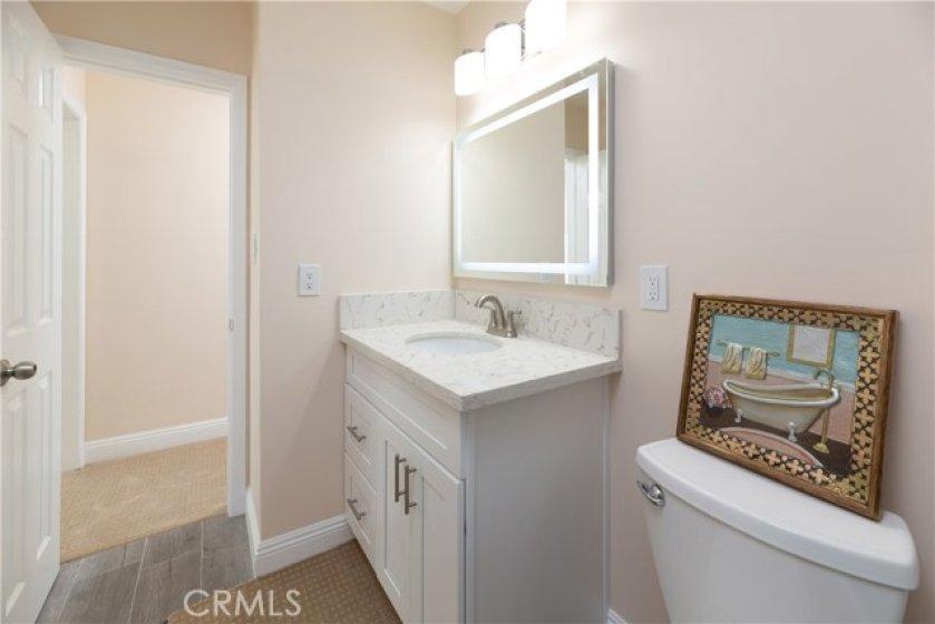 Full Guest Bath Has New Cabinet, Quartz Counters, Designer Lighting And Porcelain Tiled Bath Tub Surround