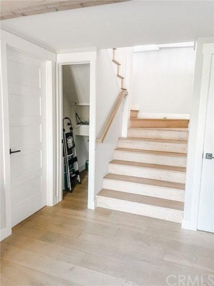 BOTTOM OF STAIRS WITH CLOSET
