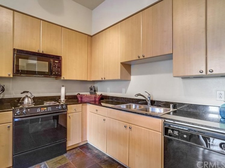 Kitchen with granite countertops.  All appliances included.