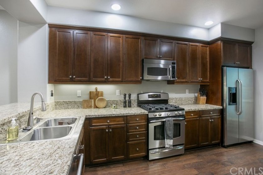 Lots of storage, granite counters and stainless steel appliances in your gourmet kitchen.