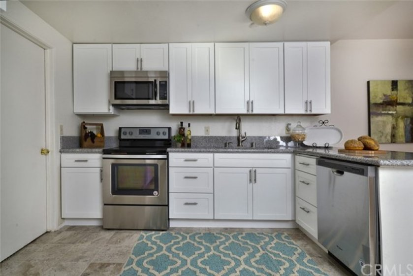This really is a lovely kitchen, with ample cabinet and counter top space.  There also room for a kitchenette or bistro set in the corner to the right and behind the photo.