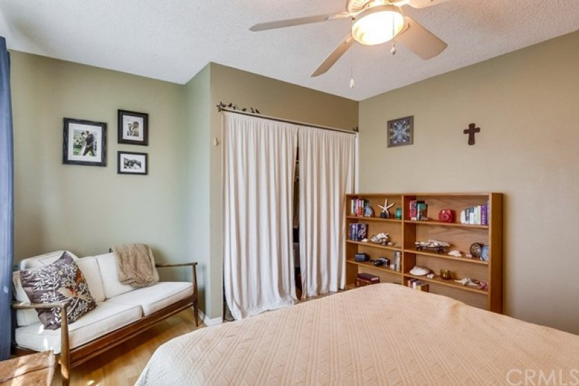 Same bedroom. showing sitting area with A/C behind and nice closet.