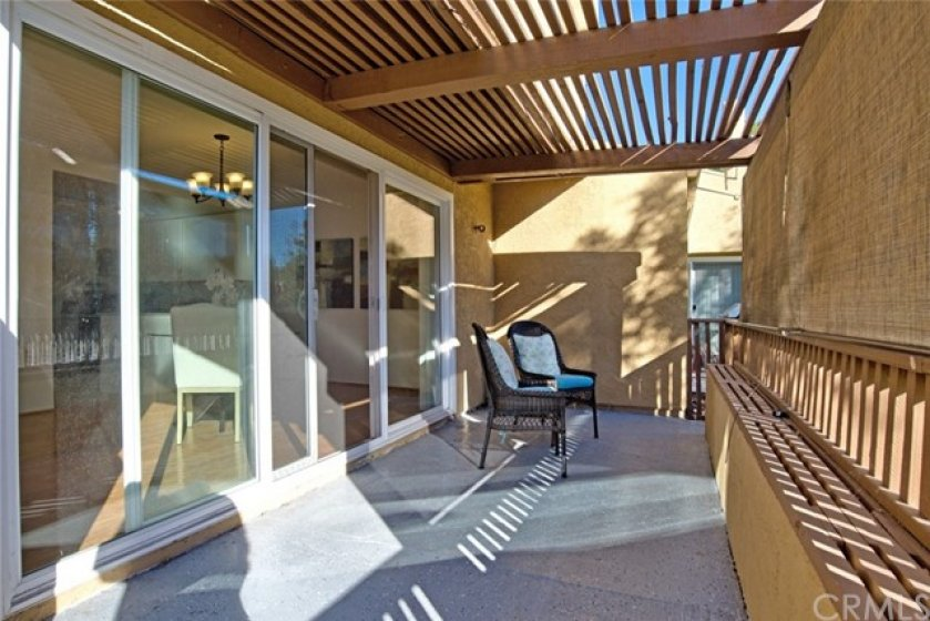 This covered patio has plenty of space and a fresh coat of epoxy covering the concrete.