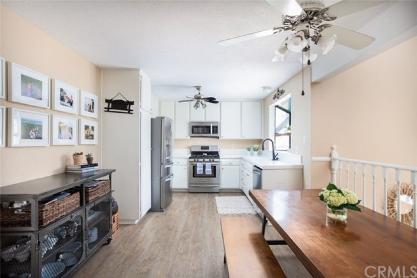 The kitchen features plentiful cabinetry, stainless steel appliances and a bay window overlooking the private patio.  The 3-car attached garage has a door with direct access into the kitchen.