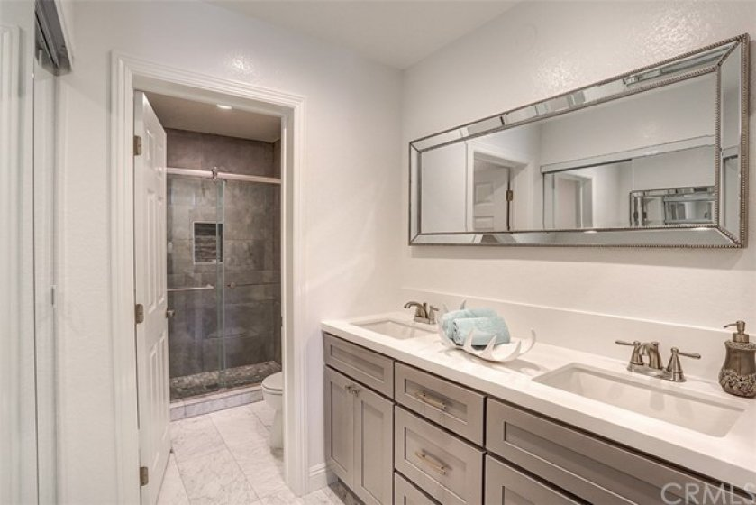 Completely remodeled master bathroom and walk in closet to the left
