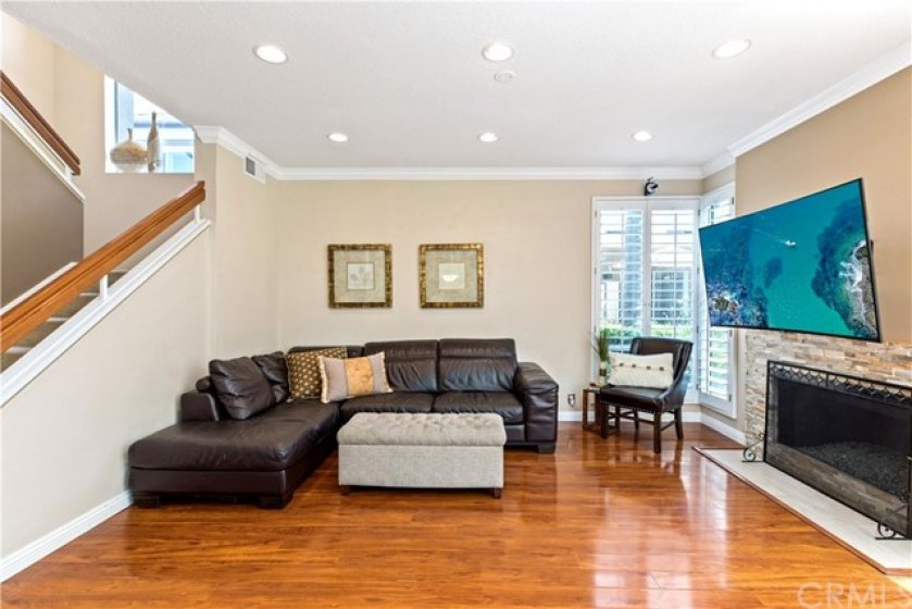 Another view of the family room, with recessed lights and lots of windows.