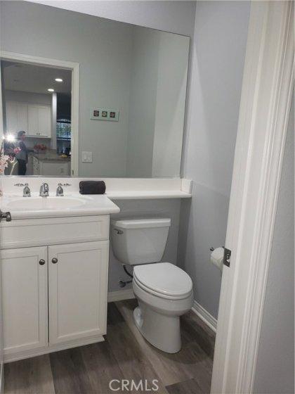 Pretty powder room 1st floor - very nice with full mirror, recessed lighting - LVP in here so easy clean, waterproof flooring.