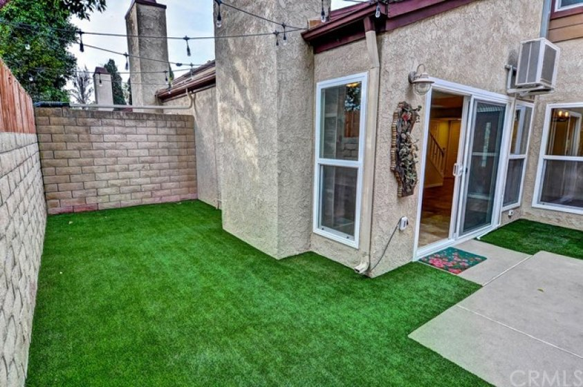 Large yard area with artificial turf.