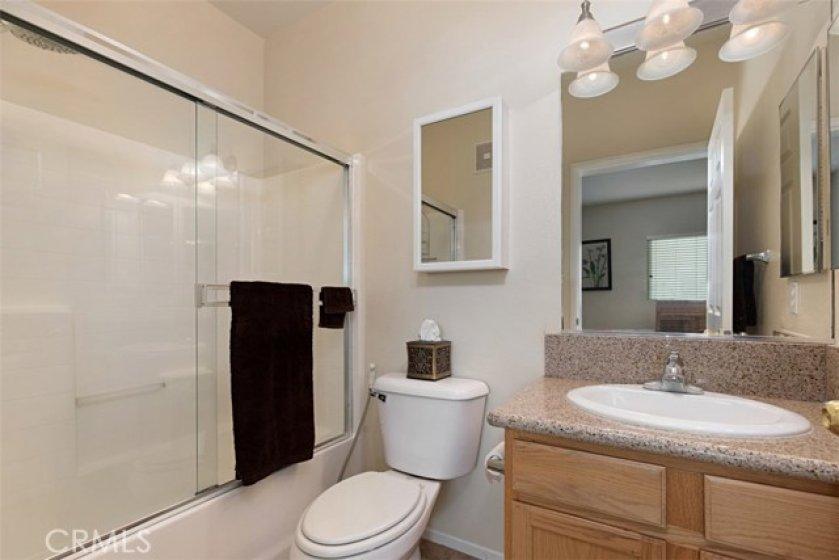 Master bathroom. Tub/shower, granite counter tops.