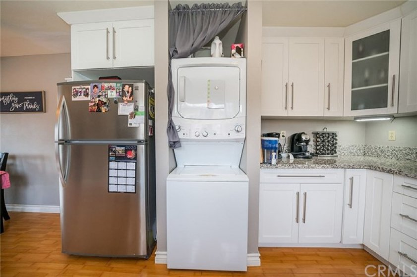 Newer fridge, inside and convenient stack able dryer/washer to make the most of this kitchen.