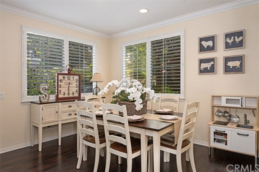The invitng dining room is spacious and adjacent to the sliding door to the patio/yard area