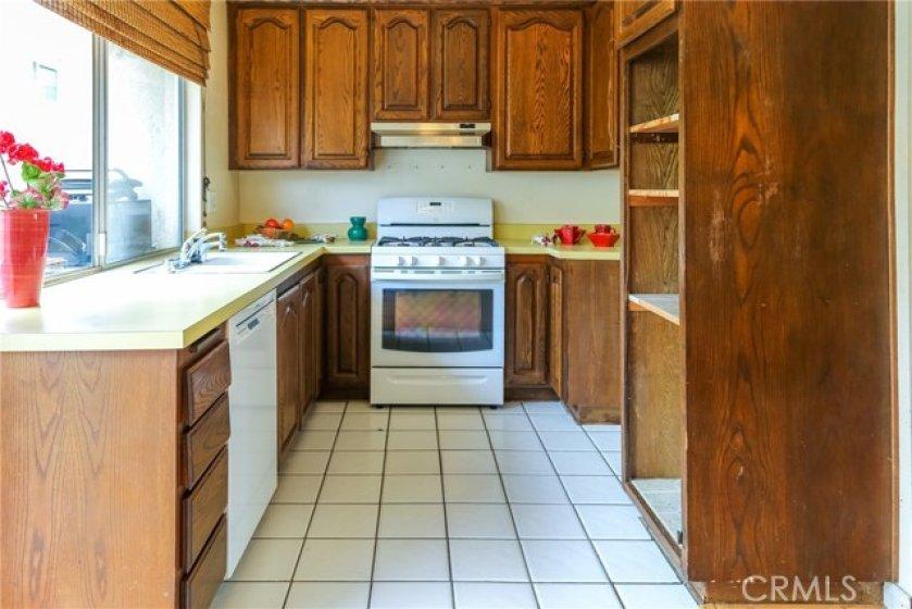 Kitchen has ceramic tile floor.