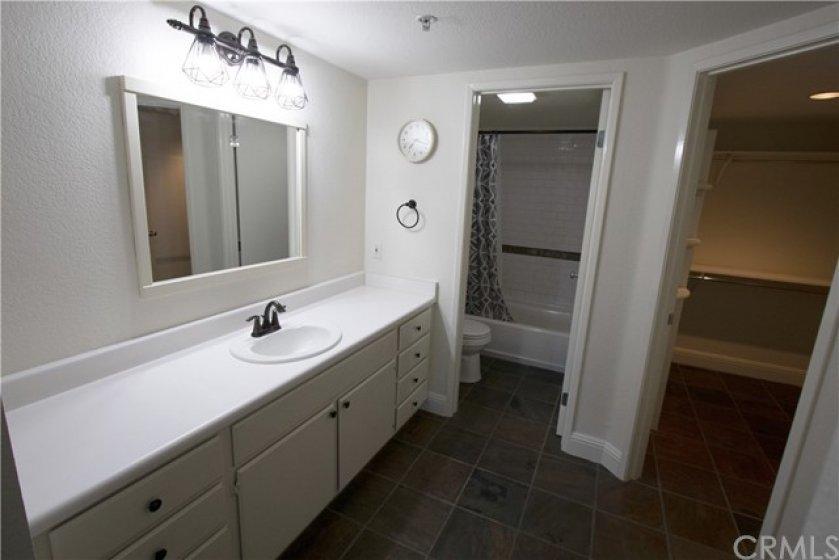large bathroom and walk in closet suite