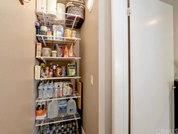 Half of the downstairs storage closet has been converted to a pantry making good use of the extra space.