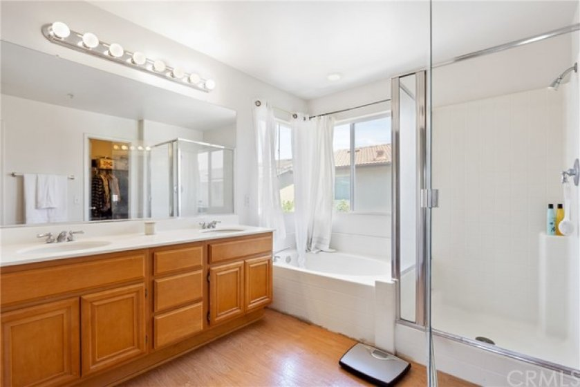 Master Bath with dual vanity, separate tub & shower and walk-in closet