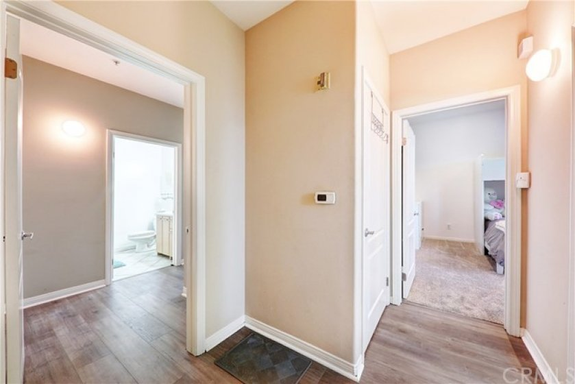 Private hallway leading to either Master suite (left) or 1st bedroom (right)