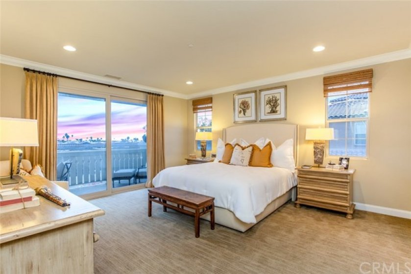 Enjoy the ocean and sunset views on your private balcony in this luxuriously sized master.