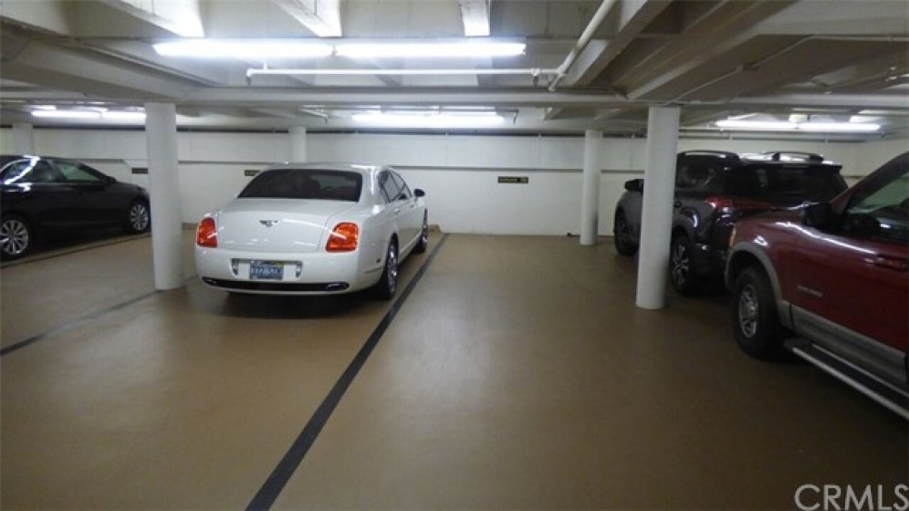 Private, assigned two car tandem parking, same level as unit, so an easy walk form car to unit after shopping, no stairs or elevator needed.