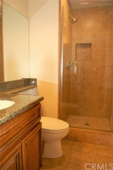 Master bathroom with custom shower. There was extra electrical added below the cabinet for other uses.