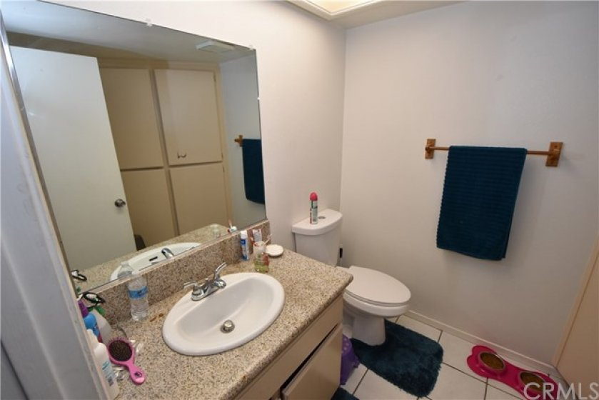 First floor bathroom features granite counter tops, tile floors and water conserving toilets.