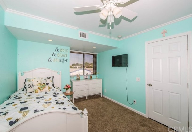 recently painted, newer carpet, ceiling fan, crown molding, baseboards a must see