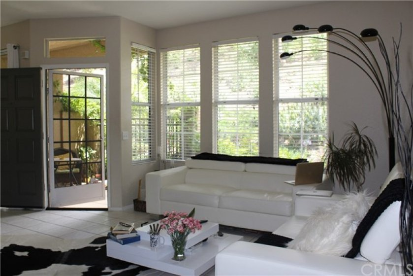 Nice size living room with view of quiet greenbelt. THIS PROPERTY DOES NOT BACK,SIDE OR FRONT TO EL TORO ROAD TRAFFIC STREET. ALSO, DOES NOT FRONT THE PARKING LOT WHERE YOU CAN EXPERIENCE CAR NOISE AND LIGHTS.