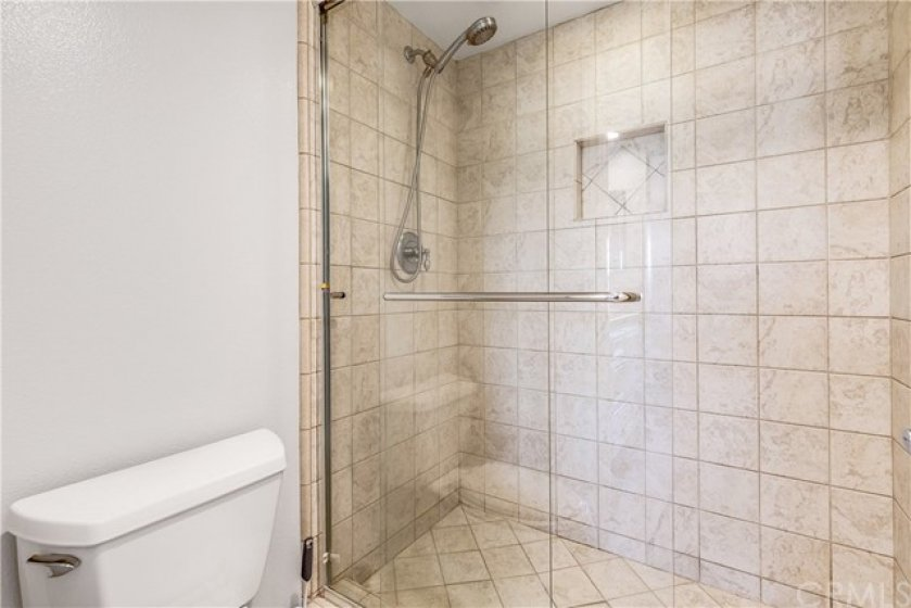 Primary bath offers convenient step-in shower
