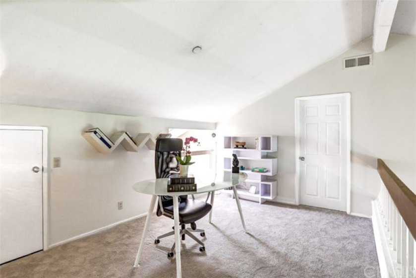 View of the upstairs loft leads to the bonus room