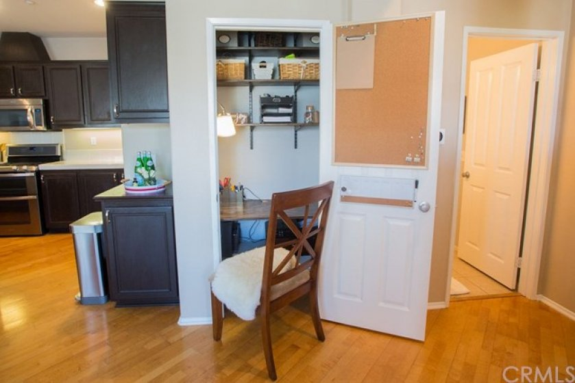 There is a closet next to the kitchen that features a desk and shelves-the perfect workspace hideaway.