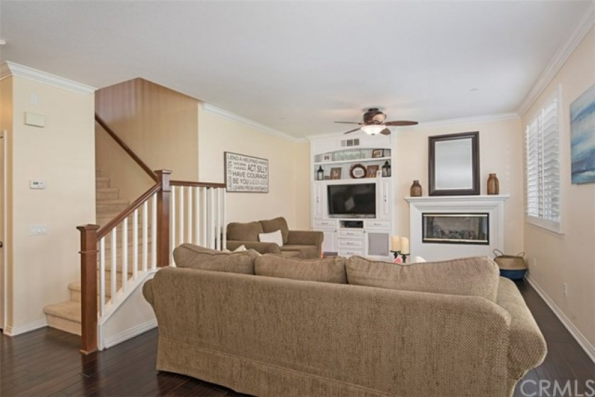 Another angle of the living room with ceiling fan
