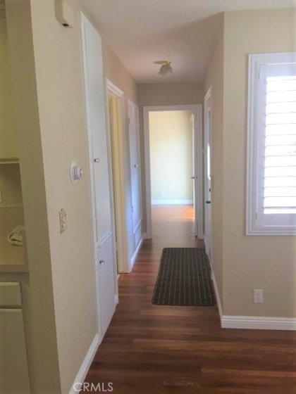 Hallway leads to bedroom, bathroom and side yard, patio and garage.