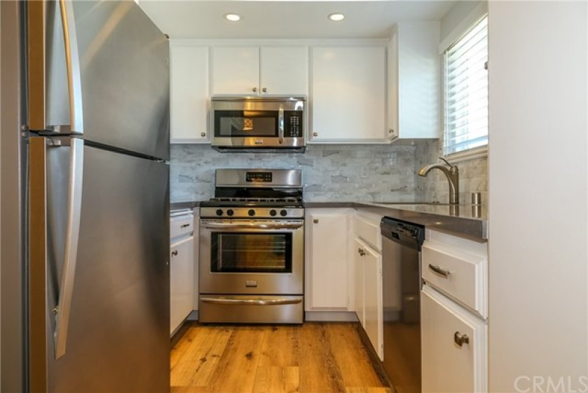 THE BEAUTIFUL KITCHEN WITH NEWER STAINLESS APPLIANCES. REFRIGERATOR INCLUDED.