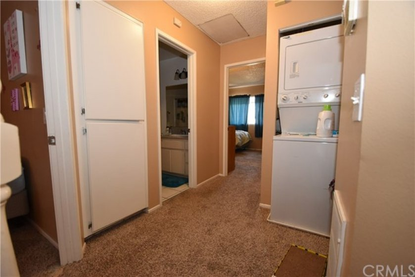 Second floor hallway. Laundry closet to right provides convenient indoor laundry facility.