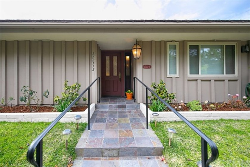 Great curb appeal with slate front walk way and lighting